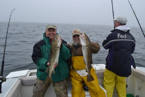 Happy fishermen with catch of the day maine ocean adventures for Deep sea fishing maine